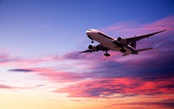 Commercial Aircraft Landing from Bright Twilight Sky